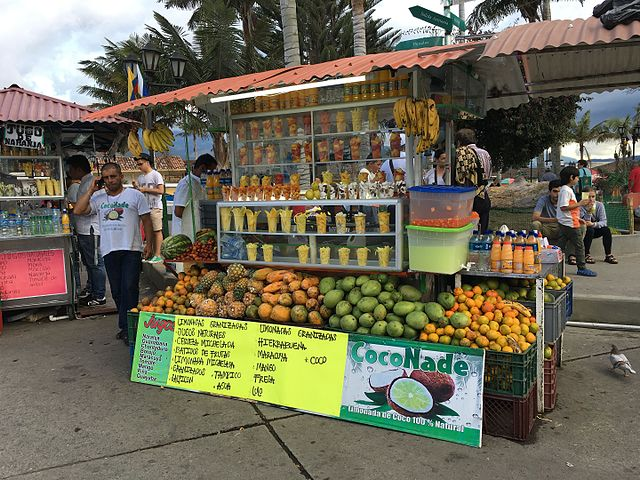 A smoothie stand with fruit in a Farmer's Market in Quindio, Colombia